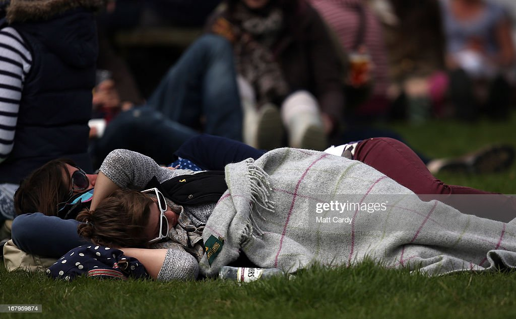 Visitors to the Badminton Horse Trials sleep under blankets on the second day of the Mitsubishi sponsored event on May 3, 2013 in Badminton, Gloucestershire. The event, which runs until Monday and is held on the Duke of Beaufort's estate, is now in its 22nd year but was cancelled last year due to flooding. It is widely seen by many as one of the highlights in the equestrian eventing calendar.