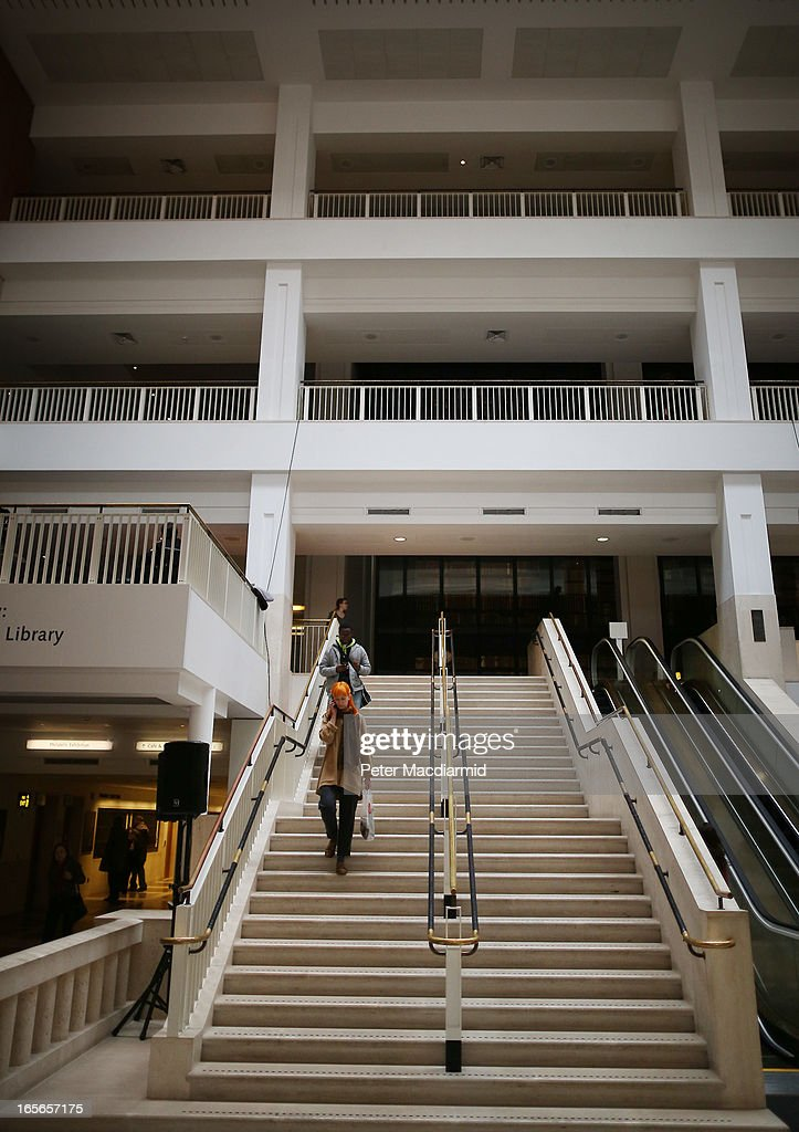 Visitors to The British Library use the main staircase on April 5, 2013 in London, England. The British Library and four other organisations have been given the right to archive the digital world from today. An estimated billion pages a year will be available for researchers to access through the new archive.