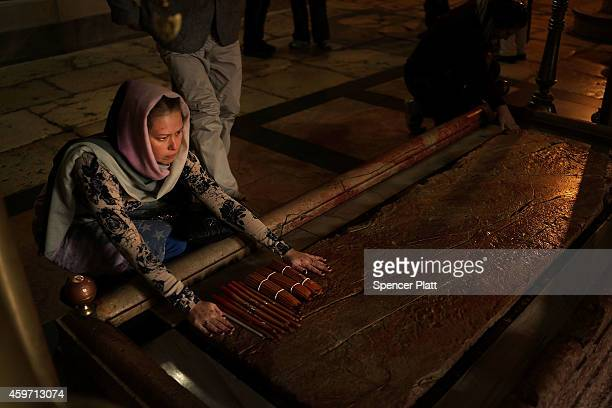 Visitors to the Church of the Holy Sepulchre kiss and touch the Stone of Anointing where Jesus's body is said to have been anointed before burial on...