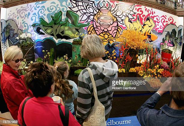 Visitors to the Flower and Garden Show admire the displays during the Melbourne International Flower and Garden Show at the Royal Exhibition Buidling...