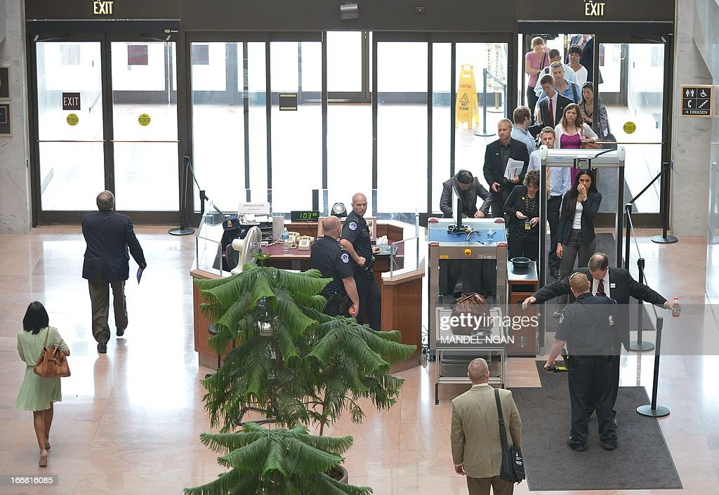 Visitors to the Hart Senate Office Building line up to pass through a security check after the building was re-opened on April 17, 2013 on Capitol Hill in Washington, DC. The building was closed earlier following reports of a suspicious package. AFP PHOTO/Mandel NGAN