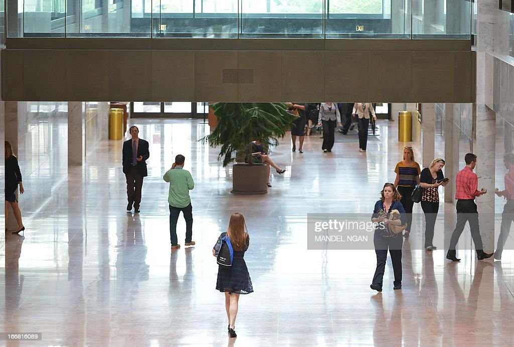 Visitors to the Hart Senate Office Building return to business after the building was re-opened on April 17, 2013 on Capitol Hill in Washington, DC. The building was closed earlier following reports of a suspicious package. AFP PHOTO/Mandel NGAN