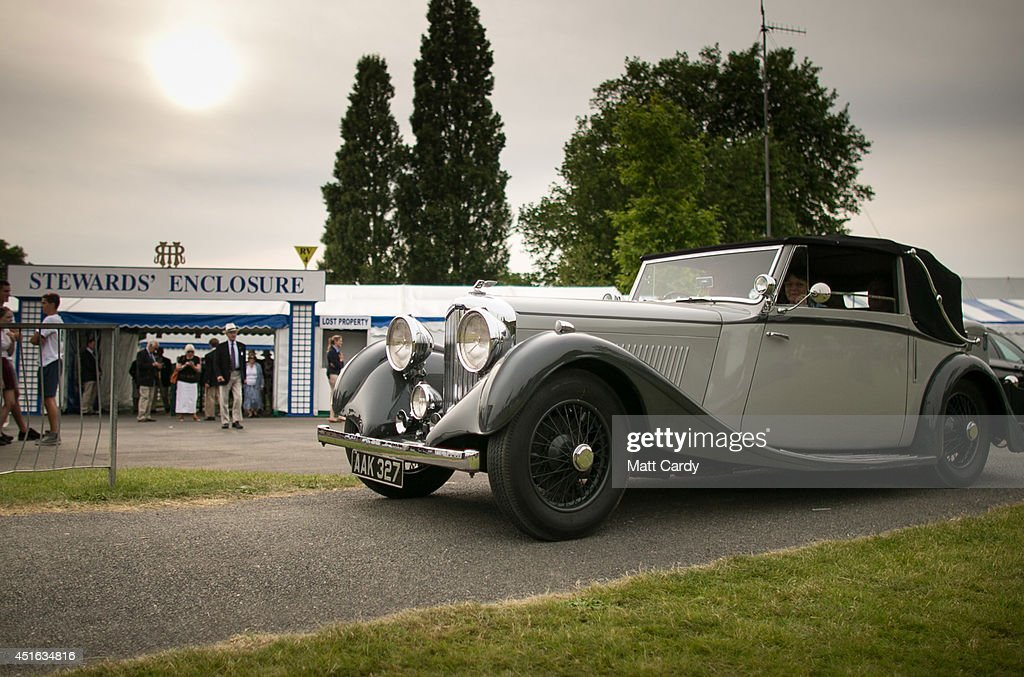 Visitors to the Henley Royal Regatta leave in a 1930s Bentley car on July 2, 2014 in Henley-on-Thames, England. Opening today and celebrating its 175th year, the Henley Royal Regatta is regarded as part of the English social season and is held annually over five days on the River Thames. Thousands of rowing fans are expected to come to watch races which are head-to-head knock out competitions, raced over a course of 1 mile, 550 yards (2,112 m) which regularly attracts international crews to race.