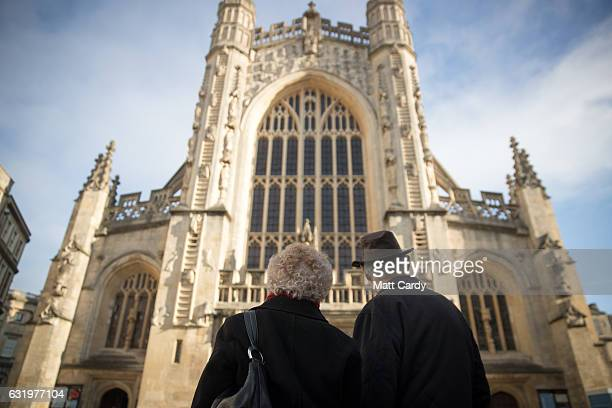 Visitors to the historic city of Bath admire the west front of the Bath Abbey on January 18 2017 in Bath England Plans for a possible overnight...