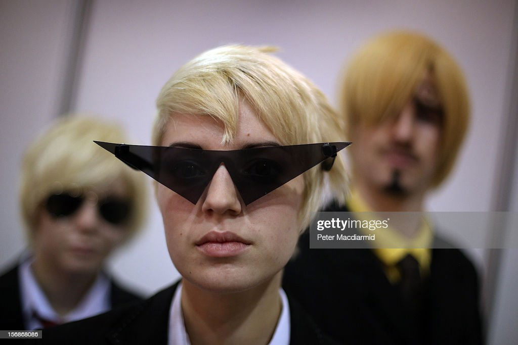 Visitors to The Hyper Japan event at Earls Court dress up as characters (L-R) Dave, Dirk and Sanji on November 23, 2012 in London, England. The show is the UK's biggest Japanese Culture event, with stalls selling clothing and artwork. live music, Japanese food and computer gaming areas are also on show. Many attendees dress up as anime characters or in the lolita fashion widespread in Japan.