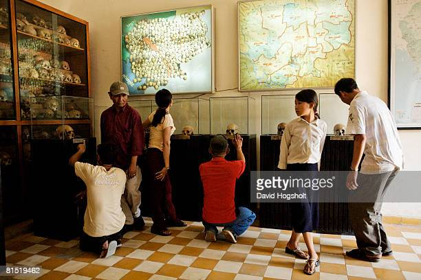 Visitors to the infamous S21 prison May 2 2007 in Phnom Penh Cambodia The former prison is now a genocide museum that bears testament to the...