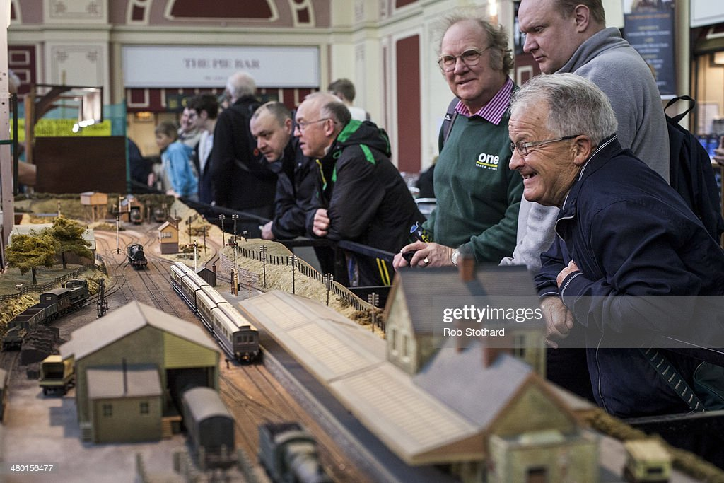 Visitors to The London Festival of Railway Modelling at Alexandra Palace look at Abingdon model railway club's set 'Millanford' on March 23, 2014 in London, England. The London Festival of Railway Modelling will run from 22nd and 23rd March. The exhibition is London's leading railway modelling event, the weekend will see 40 working layouts on display hand-picked by The Model Railway Club with over 100 traders, clubs and societies.