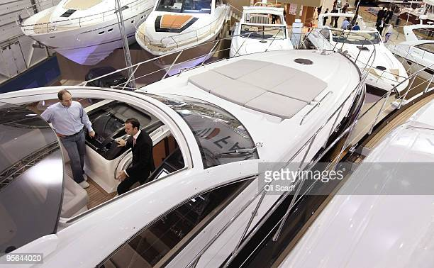 Visitors to the London International Boat Show view the huge power boats on display in the ExCeL exhibition centre on the opening day of the show on...