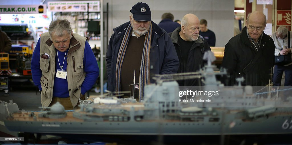 Visitors to The London Model Engineering Exhibition at Alexandra Palace look at a large scale model of HMS Warspite on January 18, 2013 in London, England. The exhibition features more than a thousand models from over 50 national and regional clubs and societies. A wide range of locomotives, boats and aircraft are on show.