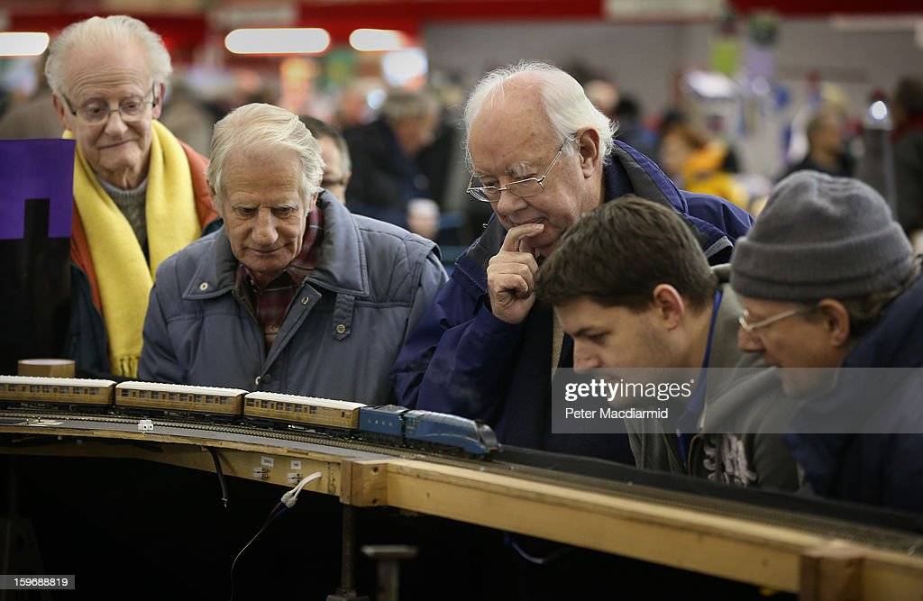 Visitors to The London Model Engineering Exhibition at Alexandra Palace look at a steam 00 scale locomotive in action on January 18, 2013 in London, England. The exhibition features more than a thousand models from over 50 national and regional clubs and societies. A wide range of locomotives, boats and aircraft are on show.