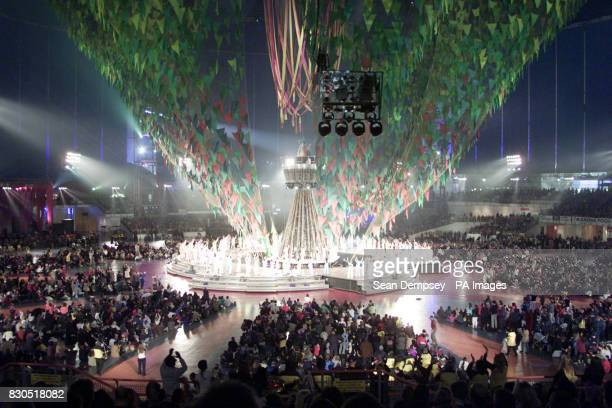 Visitors to the Millennium Dome watch the 999th and final performance of the spectacular Millennium show in the Dome's Central Arena in Greenwich...