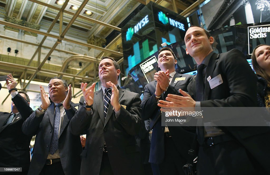 Visitors to the New York Stock Exchange applaud at the closing bell on January 24, 2013 in New York City. The Dow Jones Industrial Average and the S&P both hit 5-year highs January 24, with the Dow closing at 13,825.