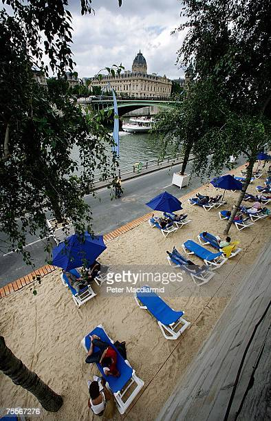 Visitors to the Paris Plage relax on sun beds next to the river Seine on July 20 2007 in Paris The Paris Plages event allows Parisians and tourists...
