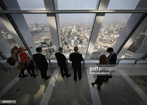 Visitors to the Sky Garden at 20 Fenchurch Street enjoy the view looking towards St Paul's Cathedral on March 12 2015 in London England Number 20...