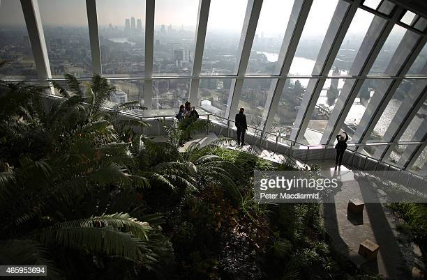 Visitors to the Sky Garden at 20 Fenchurch Street enjoy the view looking east to Canary Wharf and Tower Bridge on March 12 2015 in London England...
