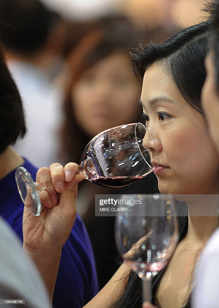 Visitors to VINEXPO Asia-Pacific sample wine in Hong Kong on May 25, 2010. The fourth Asian Vinexpo featuring 840 exhibitors from 32 countries opened in Hong Kong as the global economic crisis pushed exporters to focus on the world's most promising market: China. 'A little like 2009 vintage Bordeux, this Vinexpo is exceptional. There are more exhibitors and we expect more than 10,000 professionals, including a large number from China,' said chief executive Robert Beynat.