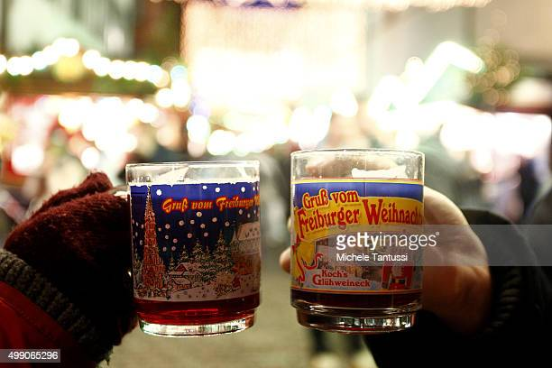 Visitors toast with mull wine at the annual christmas market on November 28 2015 in Freiburg in Breisgau Germany Christmas markets are opening across...