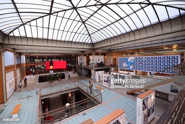 Visitors tour the 'Centre Belge de la Bande Dessinee' with a panel showing 'The Smurfs' by Belgian cartoonist Peyo on October 3 2014 in Brussels as...
