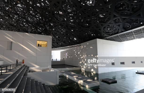 Visitors tour the Louvre Abu Dhabi Museum during the opening ceremony on November 11 2017 on Saadiyat island in the Emirati capital SAHIB