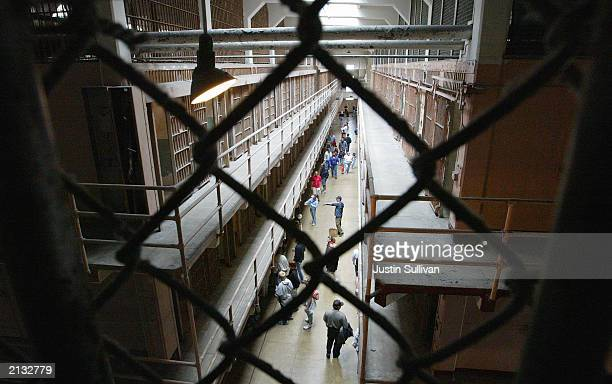 Visitors tour the mail cell block of the Alcatraz Federal Penitentiary on Alcatraz Island July 2 2003 in the San Francisco Bay California The...