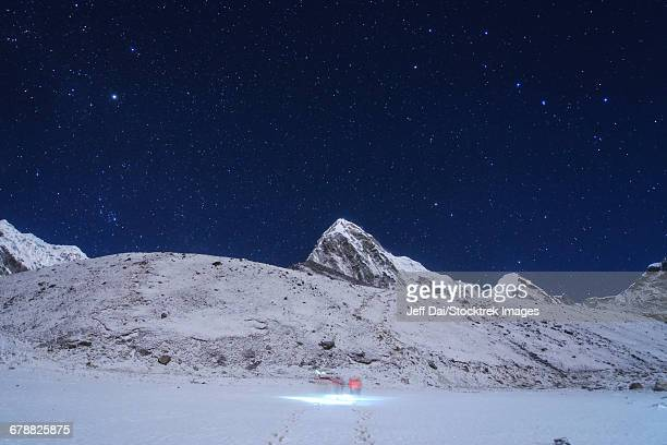 Visitors trekking to Kala Pattar in this clear moonlight night at Gorak Shep in Nepal.