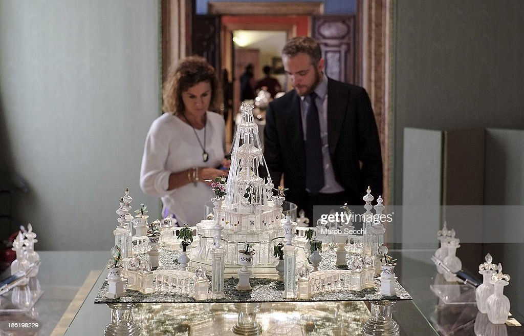 Visitors try different fragrances during the press preview of the perfume exhibition on October 29, 2013 in Venice, Italy. The new perfume section at the Venetian Museum of eighteenth-century lifestyle Palazzo Mocenigo will open on the 1st of November.