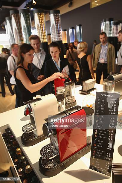 Visitors try espresso coffee at the Nespresso stand at the 2014 IFA home electronics and appliances trade fair on September 5 2014 in Berlin Germany...