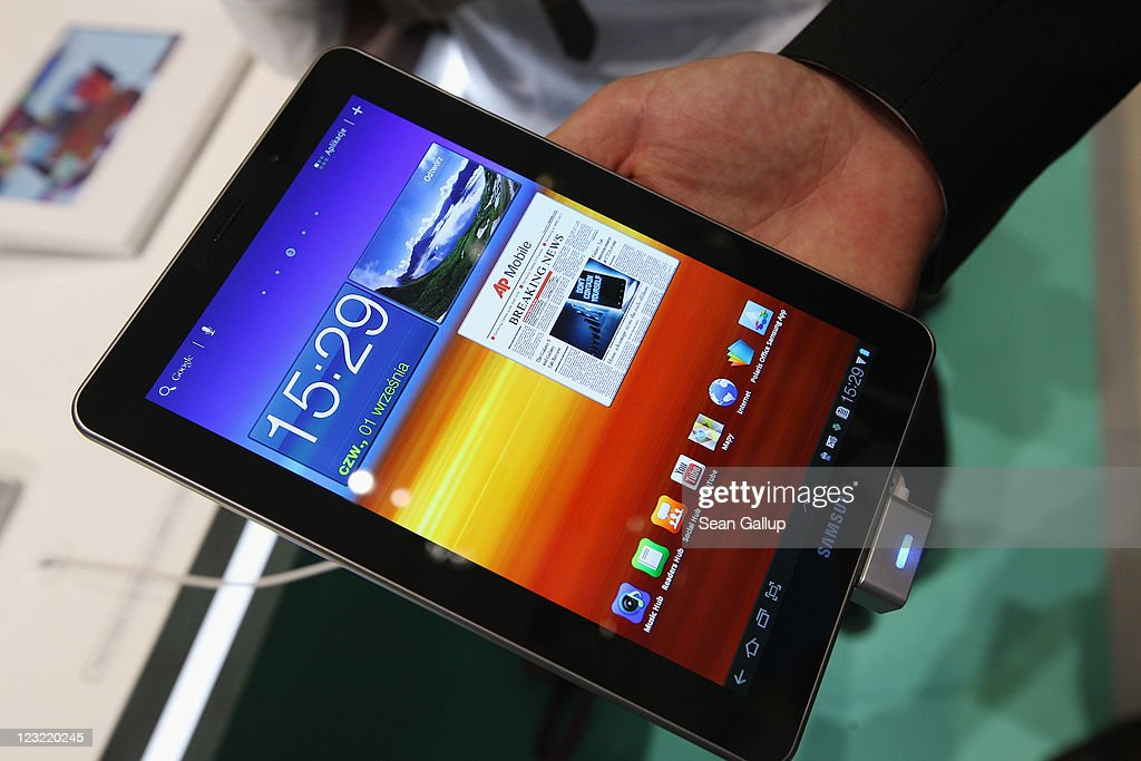 Visitors try out a Samsung Galaxy Tab 7.7 tablet at the Samsung hall at the IFA 2011 consumer electonics and appliances trade fair the day before the fair's official opening on September 1, 2011 in Berlin, Germany. The IFA 2011 will be open to the public from September 2-7.