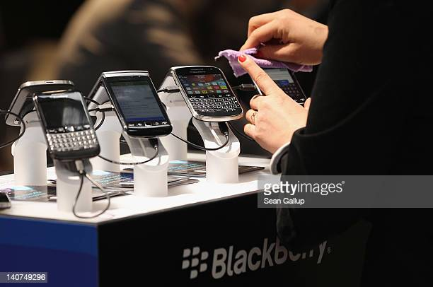 Visitors try out Blackberry smartphones at the Blackberry stand on the first day of the CeBIT 2012 technology trade fair on March 6 2012 in Hanover...