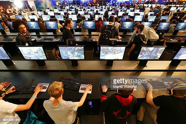 Visitors try out Blizzard at the Gamescom 2016 gaming trade fair during the media day on August 17 2016 in Cologne Germany Gamescom is the world's...