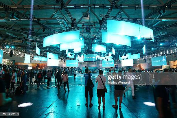 Visitors try out Electronic Arts at the Gamescom 2016 gaming trade fair during the media day on August 17 2016 in Cologne Germany Gamescom is the...