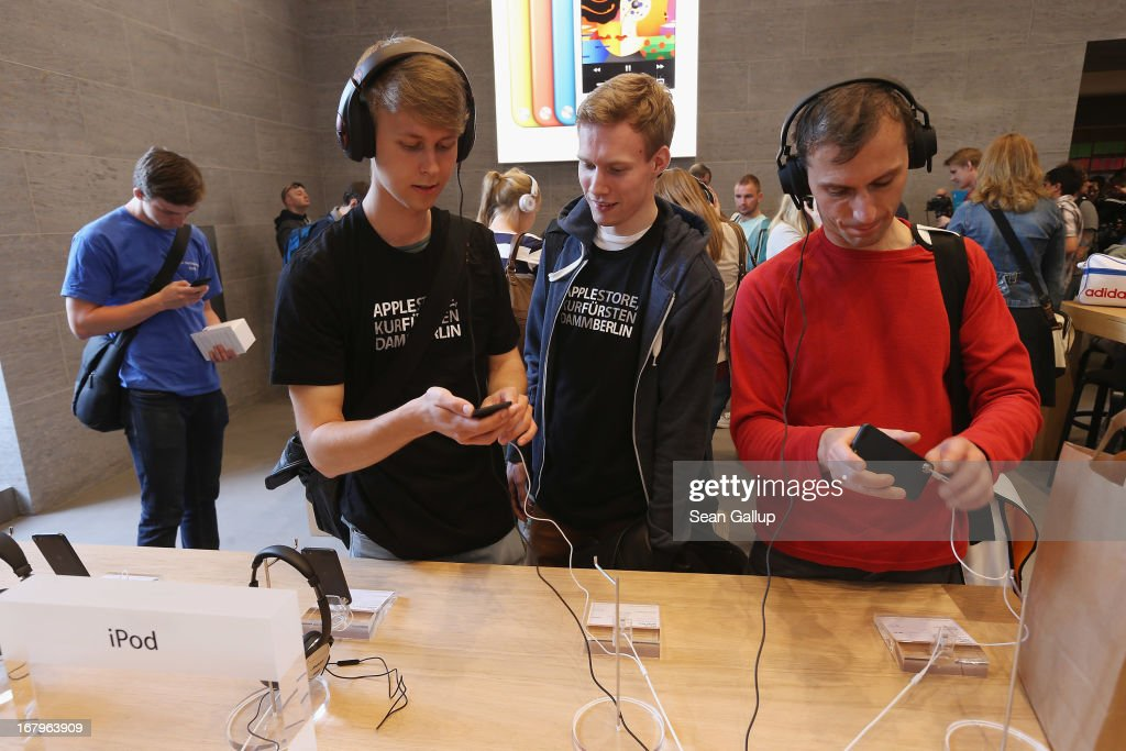 Visitors try out hifi headphones on Apple iPods at the new Apple Store on Kurfuerstendamm avenue on its opening day on May 3, 2013 in Berlin, Germany. Thousands of people waited to enter the store, which is Apple's first in Berlin and its biggest in Germany.