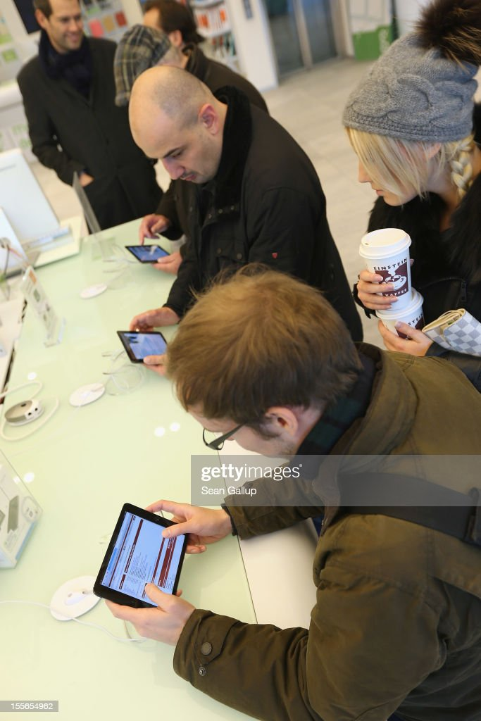 Visitors try out the Apple iPad mini at a display table at a Gravis Apple retailer on November 6, 2012 in Berlin, Germany. Apple recently released the Mini to compete with the growing number of small, tablet computers and the company is hoping for a strong Christmas season.