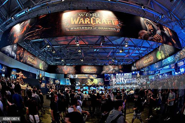 Visitors try out the massively multiplayer online roleplaying game 'World Of Warcraft' at the Blizzard Entertainment stand at the 2014 Gamescom...