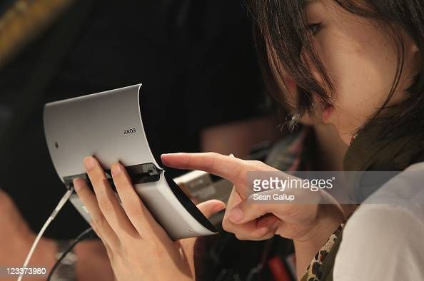 Visitors try out the new foldable Sony tablet PC at the Sony stand at the IFA 2011 consumer electonics and appliances trade fair on the first day of...