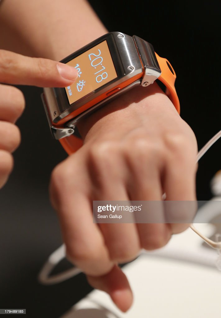 Visitors try out the new Samsung Galaxy Gear smart watch at the Samsung Unpacked 2013 Episode 2 at Tempodrom on September 4 2013 in Berlin Germany...