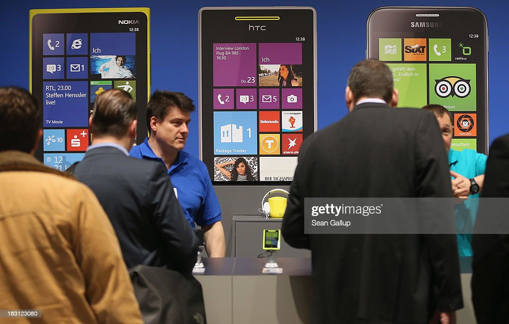 Visitors try out Windows enabled smartphones at the Microsoft stand at the 2013 CeBIT technology trade fair on March 5, 2013 in Hanover, Germany. CeBIT will be open March 5-9.