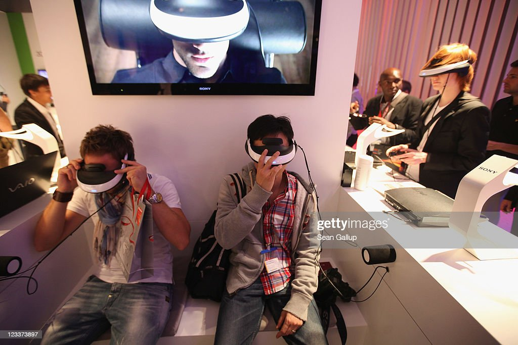 Visitors try Personal 3D Viewers at the Sony stand at the IFA 2011 consumer electonics and appliances trade fair on the first day of the fair's official opening on September 2, 2011 in Berlin, Germany. The IFA 2011 will be open to the public from September 2-7.