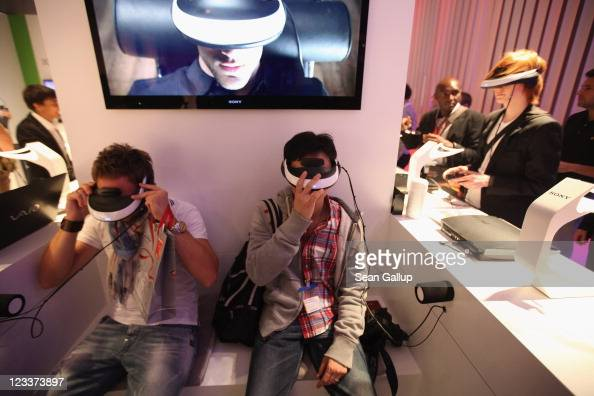 Visitors try Personal 3D Viewers at the Sony stand at the IFA 2011 consumer electonics and appliances trade fair on the first day of the fair's...