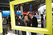 Visitors use a smartphone to take a 'selfie' photograph in the Sony Corp pavilion at the Mobile World Congress in Barcelona Spain on Wednesday March...