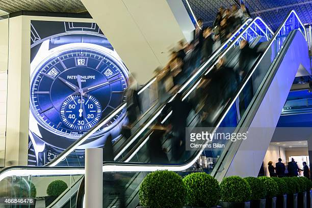 Visitors use a staircase next to a Patek Philippe display at Baselworld 2015 on March 19 2015 in Basel Switzerland