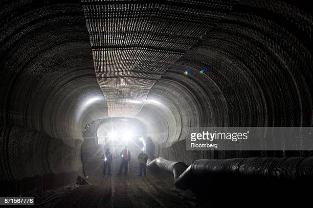 Visitors use flashlights to inspect excavations for sylvinite mineral ore used to produce potash fertilizer in the underground potash mine at the...