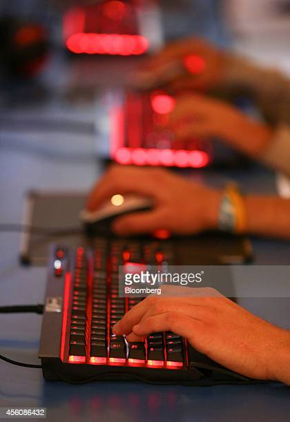 Visitors use keyboards to play computer games during the EGX gaming conference at Earls Court in London UK on Thursday Sept 25 2014 Sony Corp will...