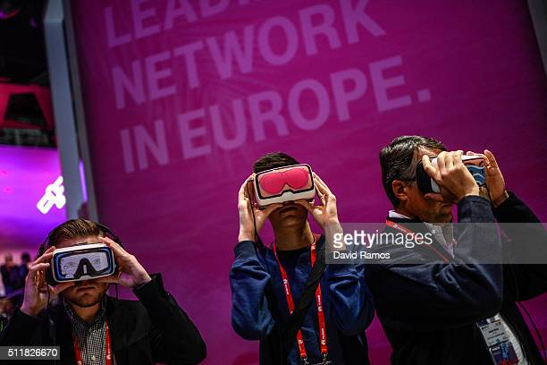 Visitors use Oculus VR virtual reality devices at Deutsche Telekom pavilion on the second day of the event at the Fira Gran Via Complex on day 2 of...