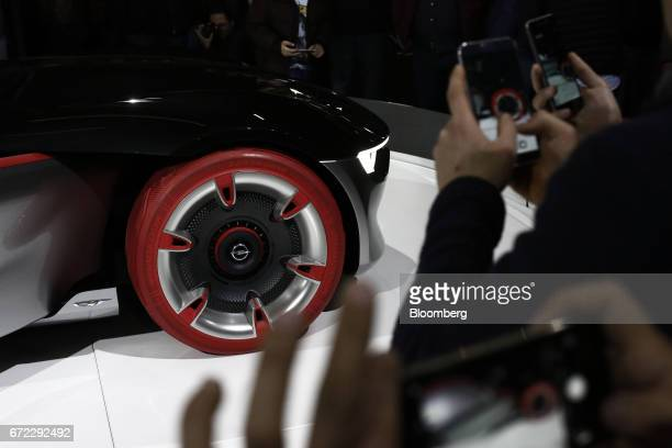 Visitors use their smartphones to photograph an Opel GT concept automobile manufactured by Adam Opel AG at the Istanbul Autoshow in Buyukcekmece...