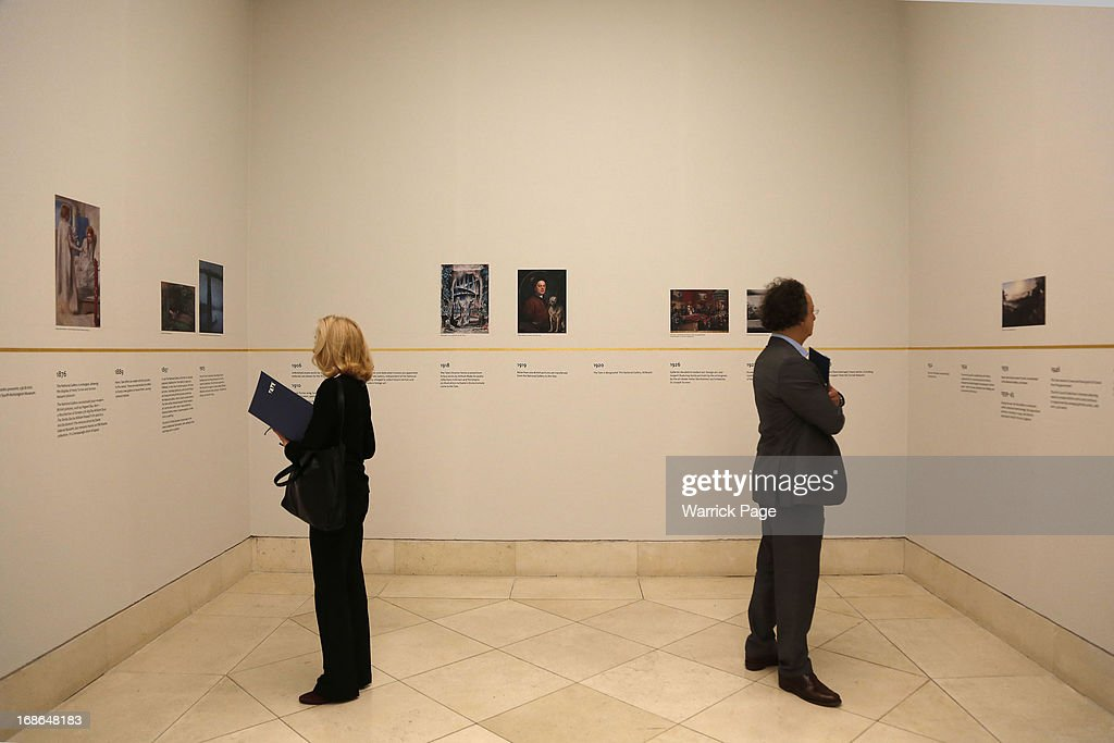 Visitors view a chronology of artwork on display at the Walk through British Art exhibition at Tate Britain on May 13, 2013 in London, England. Visitors will experience a completely new presentation of the world's greatest collection of British art, the national collection of British art will be displayed in a continuous and purely chronological display from the 1500s to the present day.