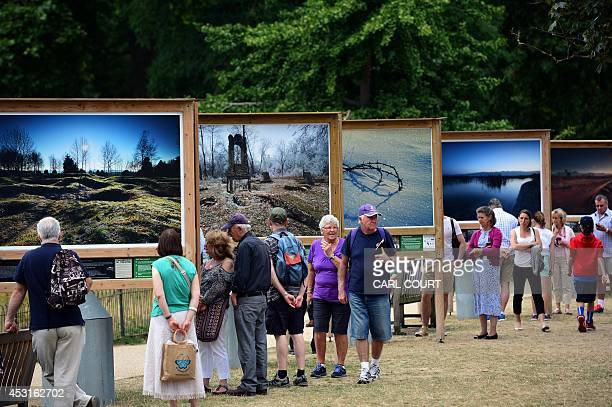 Visitors view a public exhibition of WWI landscapes entitled 'Fields of Battle Lands of Peace' created by photographer and battlefield guide Michael...