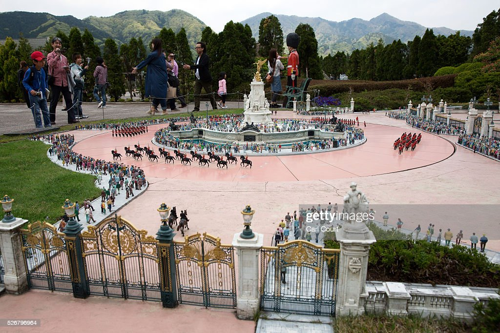 Visitors view a scale model of the Queen Victoria Monument at Tobu World Square theme park on May 01, 2016 in Nikko, Japan. Tobu World Square contains over a hundred 1:25 scale models of famous buildings, including World Heritage Sites, complete with 140,000 1:25 miniature people and receives visitors from around the world.
