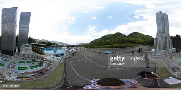 Visitors view a scale model of the World Trade Center and other monuments at Tobu World Square theme park on May 01 2016 in Nikko Japan Tobu World...