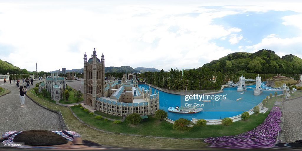 Visitors view a scale model of Tower Bridge and the Houses of Parliament at Tobu World Square theme park on May 01, 2016 in Nikko, Japan. Tobu World Square contains over a hundred 1:25 scale models of famous buildings, including World Heritage Sites, complete with 140,000 1:25 miniature people and receives visitors from around the world.